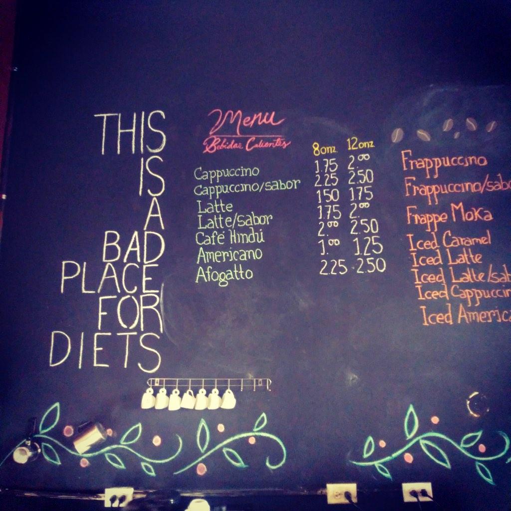 """This is a bad place for diets"" steht auf der Wandkarte des Café Espresso in Santa Ana."